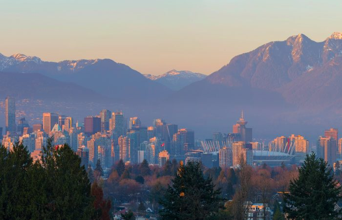 Vancouver British Columbia Canada city skyline and mountain view during sunset panorama